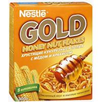 Хлопья Нестле Голд кукурузные с медом и орешками 300г